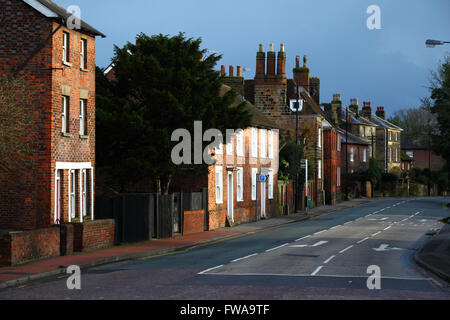View along Hadlow Road from High Street with stormy skies and sunlight, Tonbridge, Kent , England - Stock Photo
