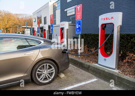 Tesla Motors, electric car charging station, in Eindhoven, The Netherlands, Tesla Superchargers, mobility, technology, - Stock Photo