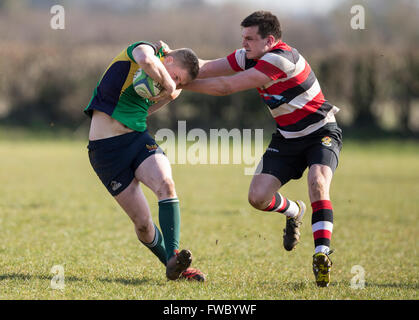 NDRFC 1st XV versus Frome RFC 1st XV,  North Dorset player being tackled. - Stock Photo