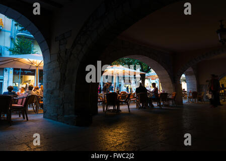 Archs in street cafe in Girona, Spain - Stock Photo