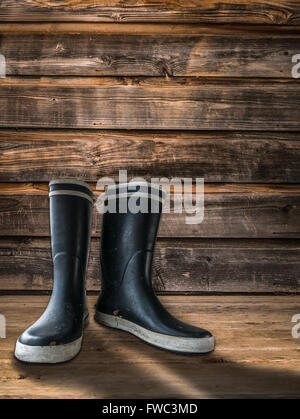 Rubber Boots On The Porch Of A Farmhouse - Stock Photo