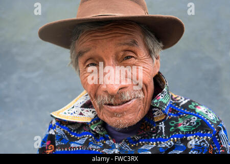 Portrait of a man in traditional dress remain in one of the streets of Chichicastenango, Guatemala. - Stock Photo