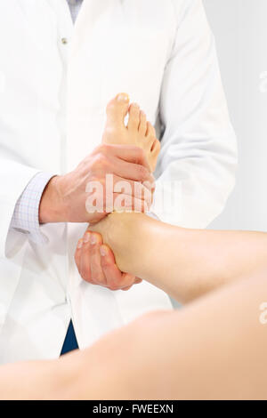 Physiotherapy, Massage legs. Alternative medicine, acupressure. Orthopedic surgeon examines the patient's foot - Stock Photo