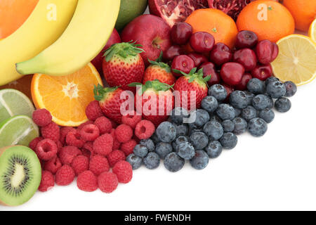 Fresh mixed fruit super food background selection with fruits high in antioxidants, vitamin c and dietary fiber - Stock Photo