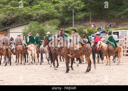 Banos, Ecuador - 30 November 2014: Group Of Young Latin Men Riding Horses Expecting Show Time, South America In - Stock Photo