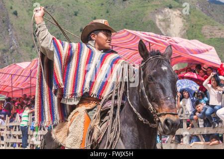 Banos, Ecuador - 30 November 2014: Young Latin Cowboy Riding A Horse, The Most Impressive And Affordable Horse Rides - Stock Photo