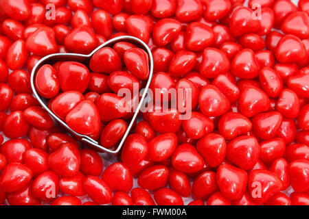Directly Above Shot Of Pastry Cutter With Red Heart Shape Food - Stock Photo