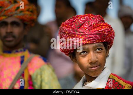 Close-up of a boy wearing a turban, Pushkar Rajasthan, India - Stock Photo