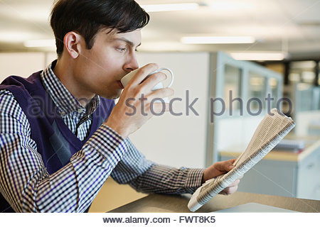 Businessman using laptop in coffee shop - Stock Photo