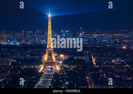 beautiful night scene of illuminated Eiffel Tower and panoramic aerial view of Paris, France - Stock Photo