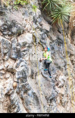 Banos, Ecuador - 30 November 2014: Basalt Challenge Of Tungurahua, Hispanic Youth Climber Performing An Exercise - Stock Photo