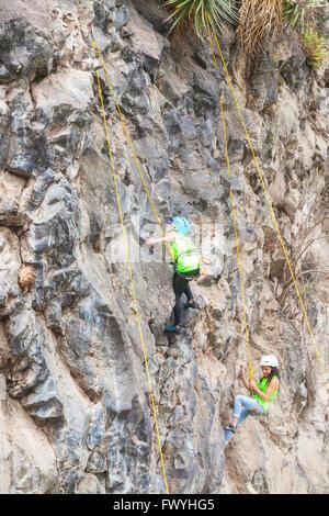 Banos, Ecuador - 30 November 2014: Basalt Challenge Of Tungurahua, Hispanic Youth Team Climbers Performing An Exercise - Stock Photo
