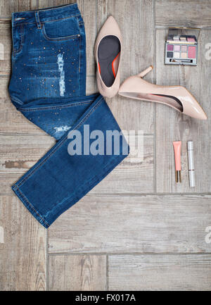 Flat lay photo of girl's jeans and accessories - Stock Photo