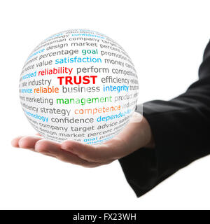 Hand take white ball with red inscription trust - Stock Photo