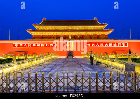 BEIJING, CHINA - JUNE 27, 2014: A soldier guards The Tiananmen Gate at Tiananmen Square. - Stock Photo