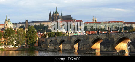 Charles Bridge and Prague at sunrice with Prague castle in the background - Stock Photo