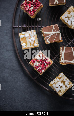 Oat brownie bites on cooling tray, dieting concept with healthy sweets - Stock Photo