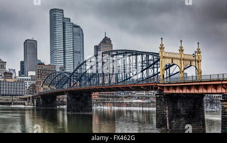 A Colorful bridge with Pittsburgh skyline - Stock Photo