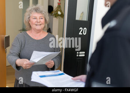 Hanover, Germany. 11th Apr, 2016. A woman receives a sheet containing instructions on the visit of US President - Stock Photo