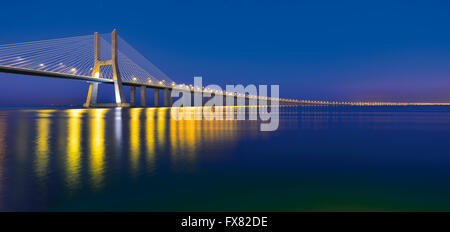Portugal, Lisbon: Nocturnal view of Vasco da Gama Bridge - Stock Photo