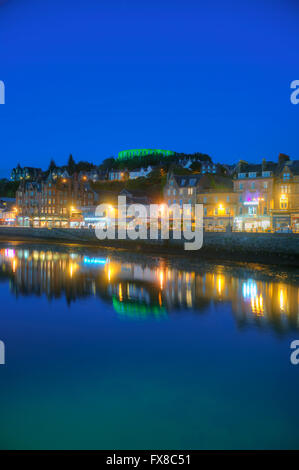 Oban at dusk with McCaigs Tower in view, Oban, Argyll - Stock Photo