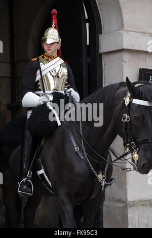 British soldier of the Blues and Royals regiment mounted on horseback - Stock Photo