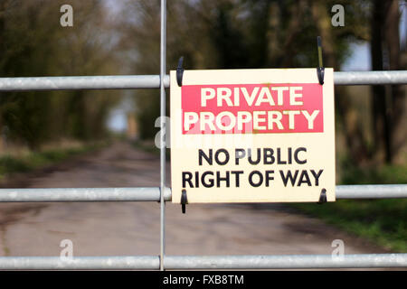 An old private property sign not allowing entry onto owners land - Stock Photo