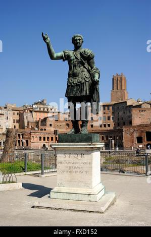 italy, rome, bronze statue of the roman emperor trajan and trajan's markets - Stock Photo
