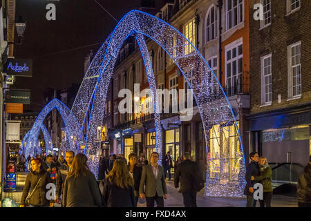 Christmas Lights  in London with an illuminated blue Arch on South Molton Street , London - Stock Photo