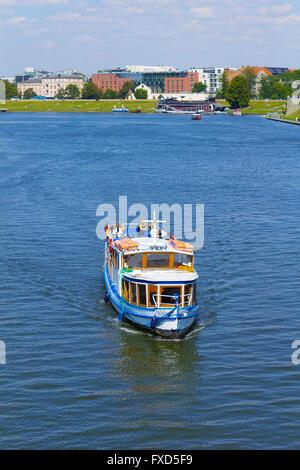 Boat on the Vistula river in the summer, Krakow, Poland - Stock Photo