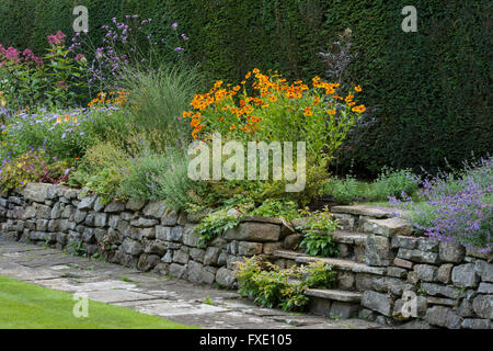 Beautiful, private, traditional, landscaped, country garden, West Yorkshire, England  - colourful flowers on the - Stock Photo