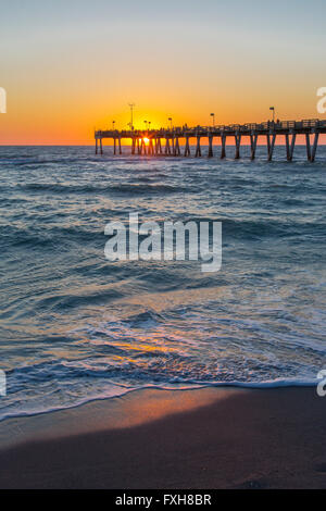 Sunset over Gulf of Mexico at Venice Pier in Venice Florida - Stock Photo