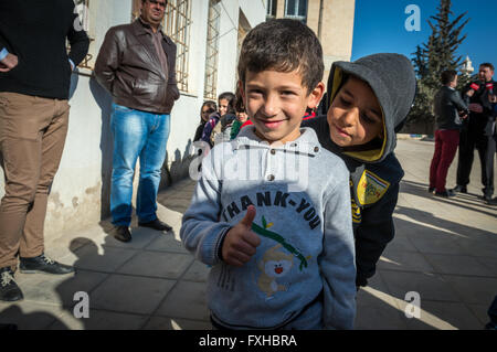 Pupils in school both for Jordan kids and Syrian refugees children in Ar Ramtha city, Jordan, 10 km from Syrian - Stock Photo