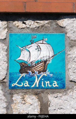 Hand painted ceramic tile displaying a house name and ship image - Stock Photo