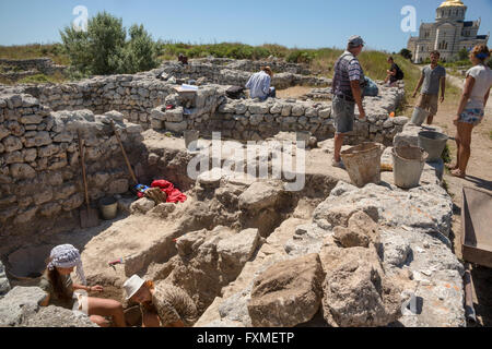 People work at archaeological excavations in the historical reserve Chersonesus in Sevastopol city, Crimea Republic - Stock Photo