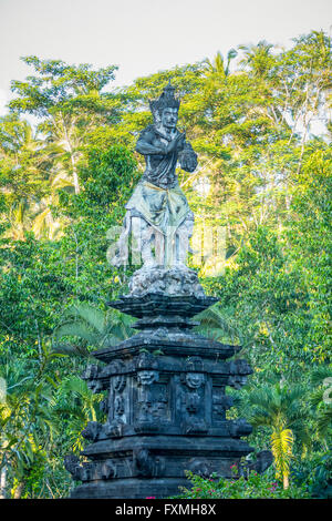 Pura Tirta Empul Statue, Ubud, Bali, Indonesia - Stock Photo