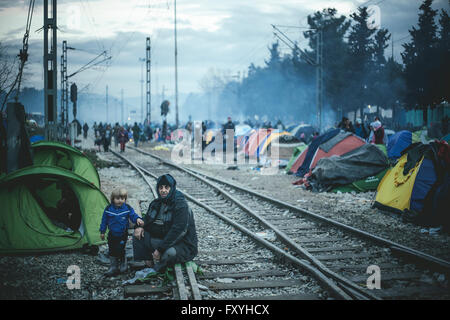 Camp with refugees on the train tracks, refugee camp in Idomeni, border with Macedonia, Greece - Stock Photo