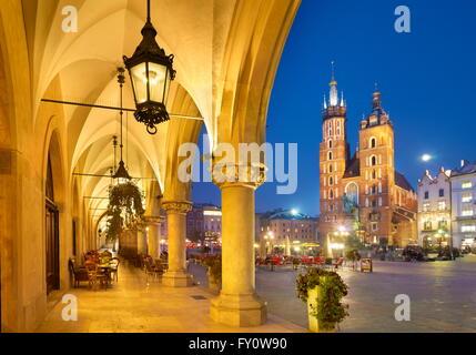 Cracow - Sukiennice (Cloth Hall) and St. Mary's Church at evening, Poland, UNESCO - Stock Photo