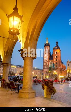 Sukiennice (Cloth Hall) and St. Mary's Church at evening, Cracow, Poland, UNESCO - Stock Photo