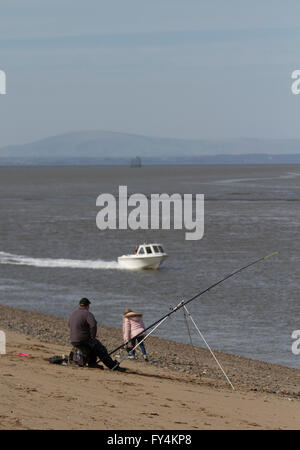 Sea Fishing, or Angling at low water on the sands of Fleetwood on the Wyre, Lancashire, coast, UK - Stock Photo
