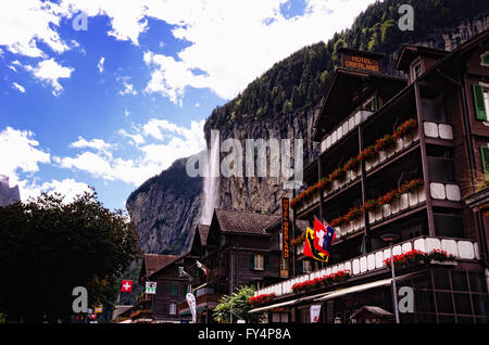 Hotel Oberland and Staubbach Falls in Lauterbrunnen (Jungfrau Region, Switzerland) - Stock Photo