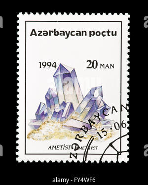 Postage stamp from Azerbaijan depicting amethyst crystals. - Stock Photo
