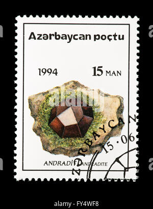 Postage stamp from Azerbaijan depicting an andradite crystal. - Stock Photo