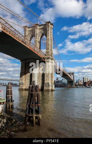 View from Manhattan near under Brooklyn Bridge , USA seen in New York. - Stock Photo