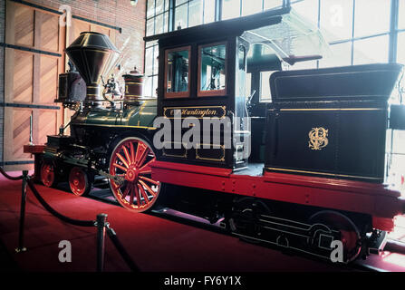 A very small 1863 steam locomotive named the C.P. Huntington for an early American railroad magnate is displayed - Stock Photo