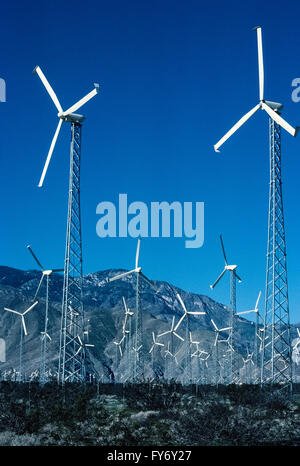 Wind turbines in the San Gorgonio Mountain Pass help provide electrical power to Palm Springs and other desert communities - Stock Photo