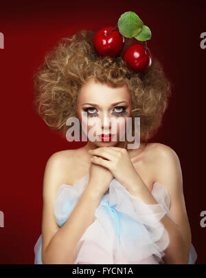 Doll woman with cherries. Artist makeup. - Stock Photo