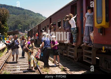 Sri Lanka, Ella Railway Station, backpackers boarding 3rd class carriage - Stock Photo