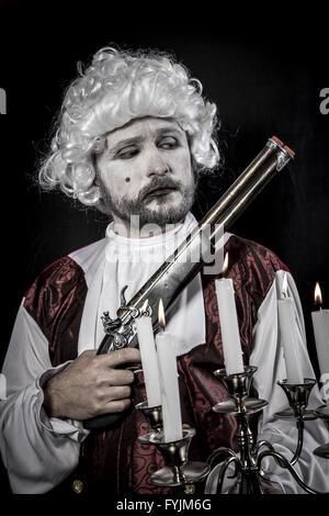 Gun, gentleman rococo era wig - Stock Photo