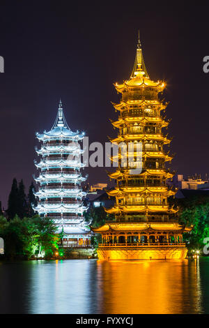 Sun and Moon twin double pagodas and Shanhu lake in Guilin - Stock Photo